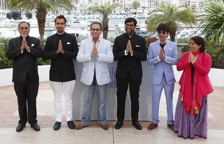 "Indian director Kanu Behl and cast members pose during a photocall for the film ""Titli"" in competition for the category ""Un Certain Regard"" at the 67th Cannes Film Festival in Cannes"