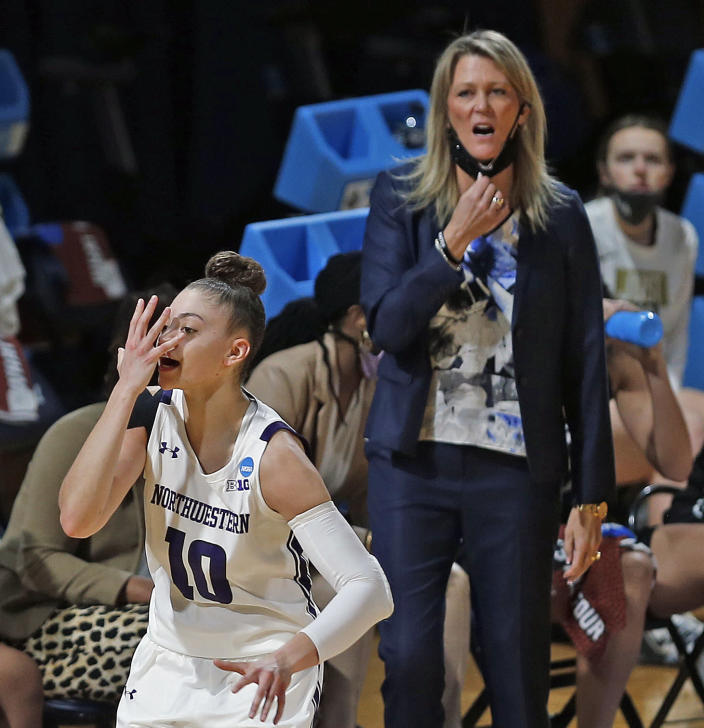 CORRECTS TO MONDAY, MARCH 22, 2021-UCF head coach Tahnee Balerio reacts to the celebration of Northwestern guard Lindsey Pulliam (10) during the first half of a college basketball game in the first round of the women's NCAA tournament at the Greehey Arena in San Antonio, Texas, Monday, March 22, 2021. (AP Photo/Ronald Cortes)