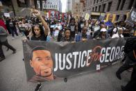 People march for the one year anniversary of George Floyd's death on Sunday, May 23, 2021, in Minneapolis, Minn. (AP Photo/Christian Monterrosa)