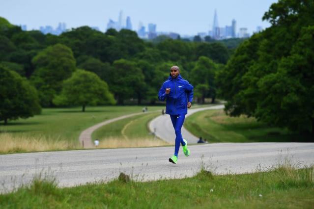 Olympic and World Champion runner Mo Farah exercises in London