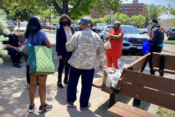 Image: NYC mayoral candidate Dianne Morales, rear center left, speaks with local residents in the Bronx, N.Y. (Nicole Acevedo / NBC News)