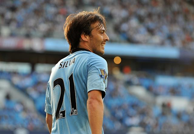 David Silva helps Manchester City to their first Premier League title by beating QPR (Photo by Manchester City FC via Getty Images)