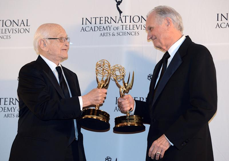 Alan Alda, right, touches statues with Norman Lear after winning Special Founders Awards at the 40th International Emmy Awards, Monday, Nov. 19, 2012 in New York. (AP Photo/Henny Ray Abrams)