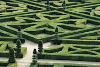 """<p>Vivacious shades of red, pink, and emerald carefully sculpted into a sprawling maze greet visitors to Château de Villandry. Jean Le Breton, Minister of Finance for François I, began cultivating the oasis of Renaissance-style gardens in 16th century in an effort to better connect the imposing castle to its nine surrounding hectacres of land. </p><p>As ownership switched over the centuries, the gardens fell to disarray until when <a href=""""https://en.wikipedia.org/wiki/Joachim_Carvallo"""" rel=""""nofollow noopener"""" target=""""_blank"""" data-ylk=""""slk:Joachim Carvallo"""" class=""""link rapid-noclick-resp"""">Joachim Carvallo</a> purchased the fallen chateau and poured time into restoring the greenery to it's full Renaissance glory. Today, Château de Villandry's property includes a bubbling water garden, an ornamental flower garden, and expansive kitchen garden.</p>"""