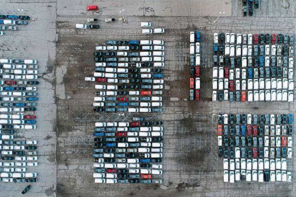 PHOTO: In this aerial photo, mid-sized pickup trucks and full-size vans are seen in a parking lot outside a General Motors assembly plant where they are produced, March 24, 2021, in Wentzville, Mo. (Jeff Roberson/AP, FILE)