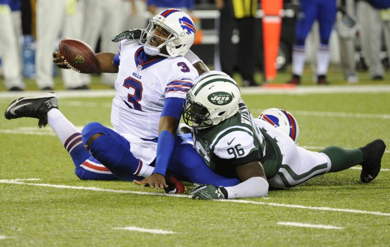 New York Jets defensive end Muhammad Wilkerson (96) sacks Buffalo Bills quarterback EJ Manuel (3) during the second half of an NFL football game Sunday, Sept. 22, 2013, in East Rutherford, N.J. The Jets won the game 27-20. (AP Photo/Bill Kostroun)