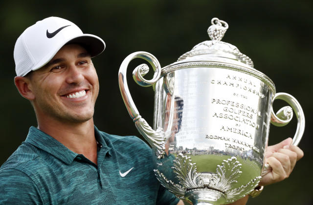 "<a class=""link rapid-noclick-resp"" href=""/pga/players/12875/"" data-ylk=""slk:Brooks Koepka"">Brooks Koepka</a> holds the Wanamaker Trophy after he won the PGA Championship at Bellerive Country Club on Sunday. (AP)"