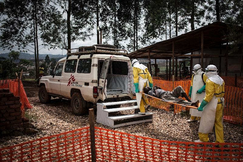 Health workers move a patient to a hospital after he was cleared of having Ebola at a Doctors Without Borders supported treatment center in Butembo, DRC in November 2018 (AFP Photo/John WESSELS)