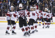 New Jersey Devils' Damon Severson (28) and teammates celebrate his score against the Vancouver Canucks during the shootout in an NHL hockey game Friday, March 15, 2019, in Vancouver, British Columbia. (Darryl Dyck/The Canadian Press via AP)