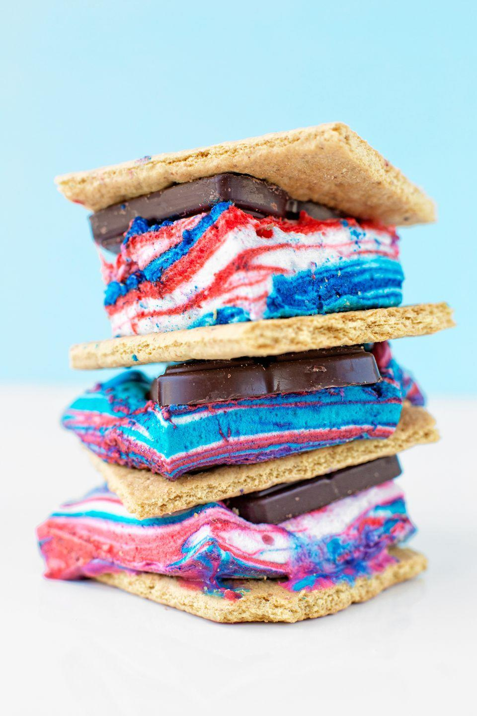 """<p>Round out the night with a sweet surprise—ooey-gooey red, white, and blue s'mores. </p><p><a class=""""link rapid-noclick-resp"""" href=""""https://studiodiy.com/tie-dye-fourth-july-smores/"""" rel=""""nofollow noopener"""" target=""""_blank"""" data-ylk=""""slk:GET THE RECIPE"""">GET THE RECIPE</a></p><p><a class=""""link rapid-noclick-resp"""" href=""""https://www.amazon.com/Marshmallow-Roasting-Extendable-PcsTelescoping-Campfire/dp/B071NP7R23/ref=sr_1_7?dchild=1&keywords=s%27mores&qid=1591629790&sr=8-7&tag=syn-yahoo-20&ascsubtag=%5Bartid%7C10072.g.32715018%5Bsrc%7Cyahoo-us"""" rel=""""nofollow noopener"""" target=""""_blank"""" data-ylk=""""slk:SHOP ROASTING STICKS"""">SHOP ROASTING STICKS</a></p>"""