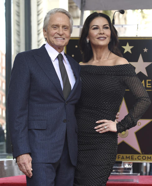 Actor Michael Douglas, left, and his wife Catherine Zeta-Jones attend a ceremony honoring Douglas with a star on the Hollywood Walk of Fame (Photo by Chris Pizzello/Invision/AP)