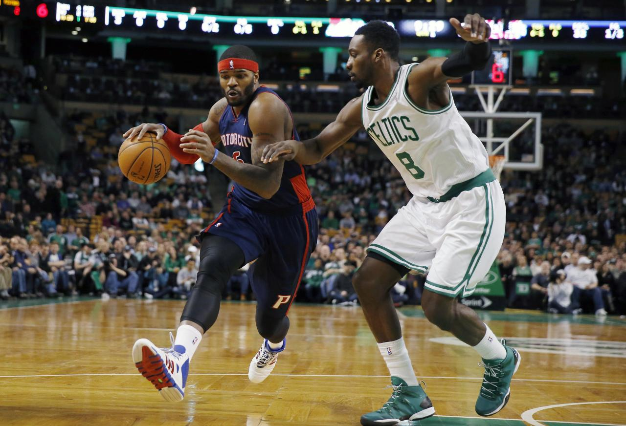 Detroit Pistons' Josh Smith (6) drives past Boston Celtics' Jeff Green (8) in the first quarter of an NBA basketball game in Boston, Sunday, March 9, 2014. (AP Photo/Michael Dwyer)