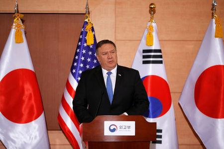 FILE PHOTO: U.S. Secretary of State Mike Pompeo addresses a news conference alongside South Korean Foreign Minister Kang Kyung-wha and Japan's Foreign Minister Taro Kono during a trilateral meeting at the Foreign Ministry in Seoul
