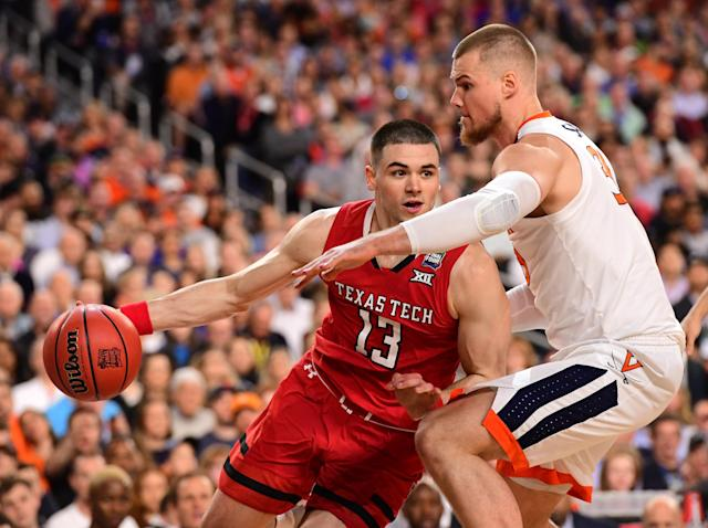 Matt Mooney #13 of the Texas Tech Red Raiders drives against Jack Salt #33 of the Virginia Cavaliers during the first half in the 2019 NCAA men's Final Four National Championship game at U.S. Bank Stadium on April 08, 2019 in Minneapolis, Minnesota. (Photo by Jamie Schwaberow/NCAA Photos via Getty Images)