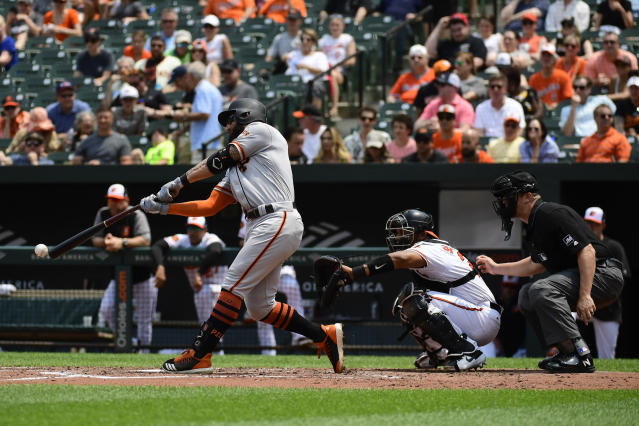 San Francisco Giants' Kevin Pillar hits a RBI double in the fourth inning of an interleague baseball game against the Baltimore Orioles , Sunday, June 2, 2019, in Baltimore. (AP Photo/Tommy Gilligan)