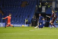 Chelsea's Christian Pulisic, center right, scores his side's third goal past Leeds United's goalkeeper Illan Meslier, left, during the English Premier League soccer match between between Chelsea and Leeds United at Stamford Bridge in London, England, Saturday, Dec. 5, 2020. (Matthew Childs/Pool via AP)