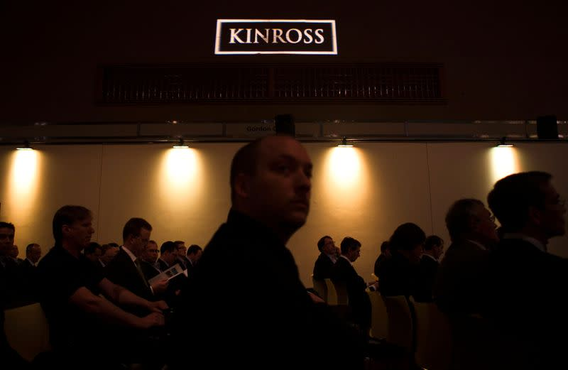 FILE PHOTO: People look on during the Kinross Gold Corporation annual general meeting for shareholders in Toronto