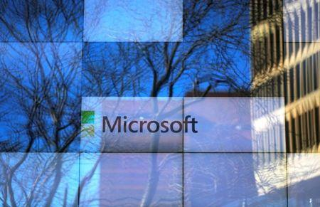 FILE PHOTO: An advertisement is played on a set of large screens at the Microsoft office in Cambridge