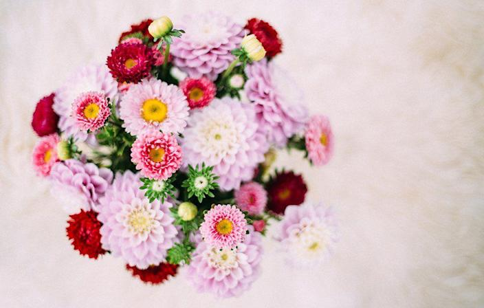 """<p>""""Every month I send my girlfriend flowers or deliver them myself. I also handwrite love letters and mail them to her at work."""" <em>–Mona</em></p>"""