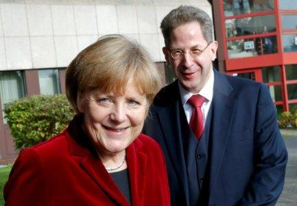 FILE PHOTO: German Chancellor Angela Merkel and Hans-Georg Maassen, the President of the Federal Office for the Protection of the Constitution, Germany's domestic security agency in Cologne, Germany October 31, 2014. REUTERS/Wolfgang Rattay/File Photo/File Photo