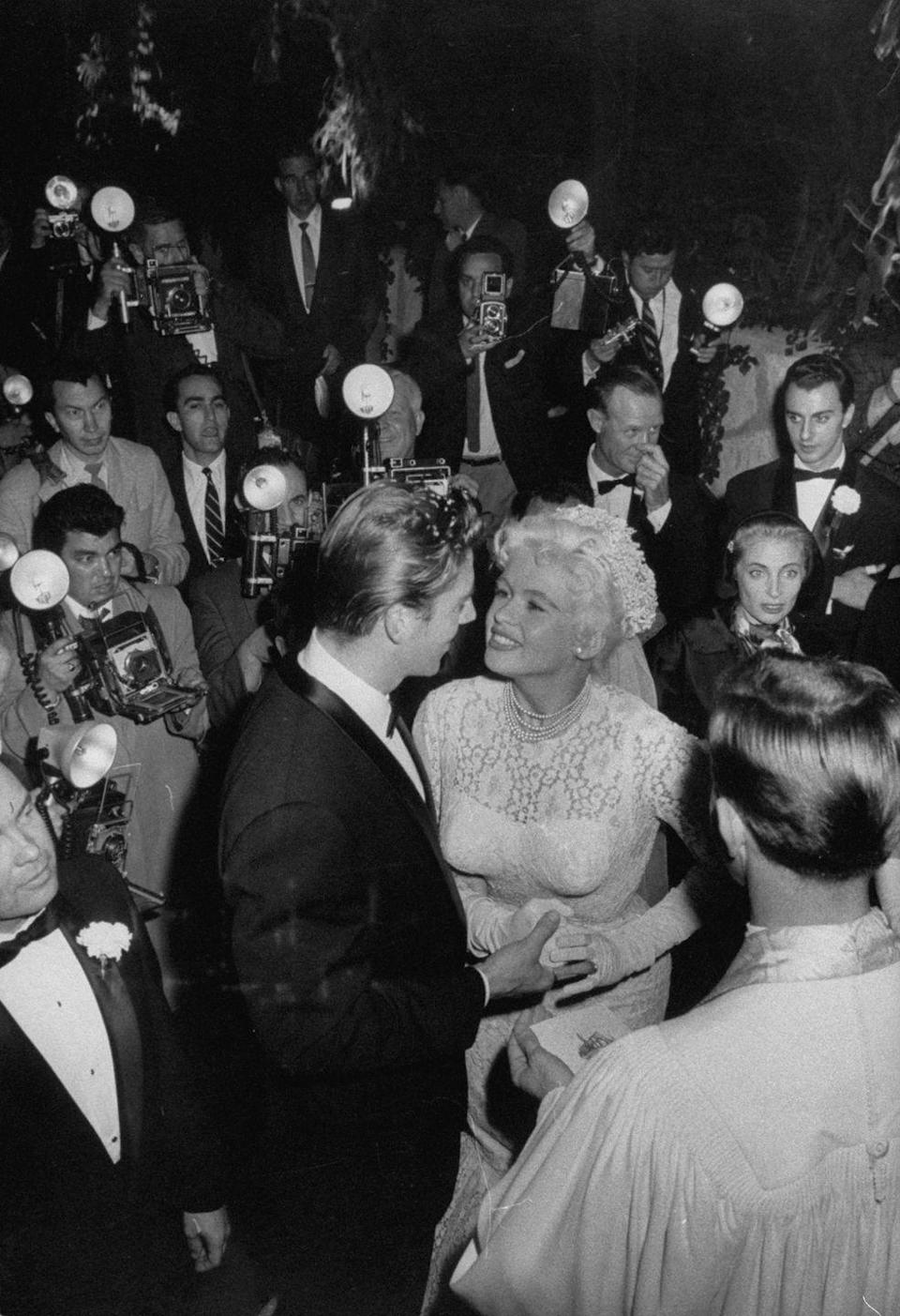 <p>Though her divorce from Paul Mansfield had only been finalized days before, actress Jayne Mansfield wed Mickey Hargitay on January 13, 1958. The Mr. Universe winner had proposed to her with 10-carat diamond ring just two months prior.</p>