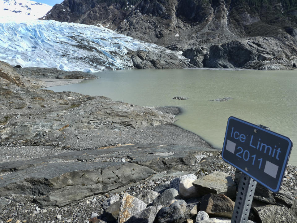 FILE - This May 9, 2020 file photo shows the Mendenhall Glacier in Juneau, Alaska. The U.S. Forest Service says the glacier, often reached by trail or by crossing Mendenhall Lake, is retreating. According to a study released on Wednesday, April 28, 2021 in the journal Nature, the world's 220,000 glaciers are melting faster now than in the 2000s. (AP Photo/Becky Bohrer)