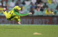 Australia's Steve Smith throws the ball during the one day international cricket match between India and Australia at the Sydney Cricket Ground in Sydney, Australia, Friday, Nov. 27, 2020. (AP Photo/Rick Rycroft)