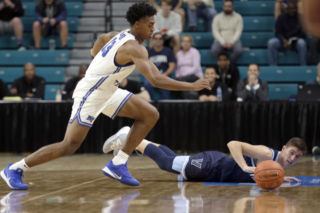 Middle Tennessee State guard Jayce Johnson (13) and Villanova guard Collin Gillespie chase the ball during the first half of an NCAA college basketball game at the Myrtle Beach Invitational in Conway, S.C., Thursday, Nov. 21, 2019. (AP Photo/Gerry Broome)