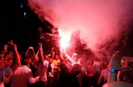 Supporters of Tunisia's moderate Islamist Ennahda party celebrate in Tunis