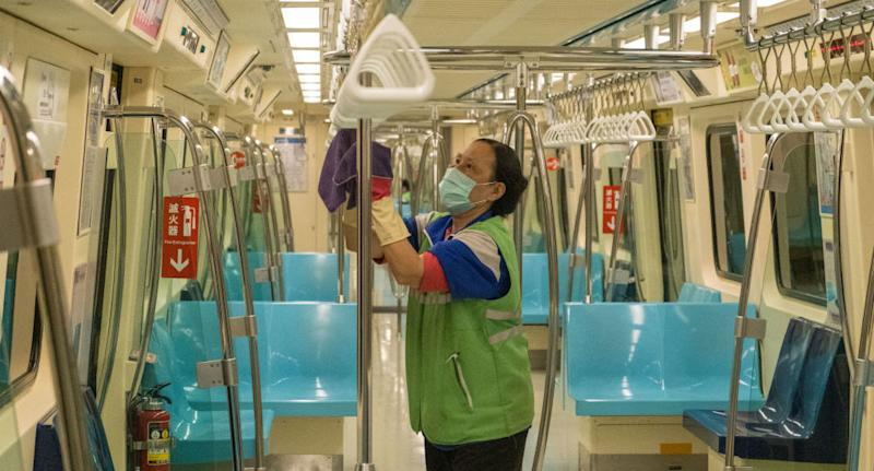 A Metro staff in Taiwan wearing a protective mask and gloves cleans and disinfects a tram as a measure against coronavirus.
