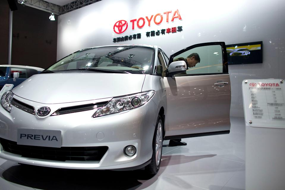 A visitor steps out of a Toyota Previa at an import car expo in Beijing, China, on Nov. 1, 2011. The Toyota Previa was discontinued in the U.S. in the 1990s.