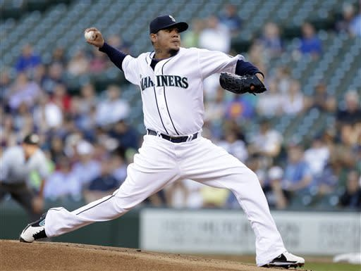 Seattle Mariners starting pitcher Felix Hernandez throws to a Chicago White Sox batter in the first inning of a baseball game Tuesday, June 4, 2013, in Seattle. (AP Photo/Elaine Thompson)