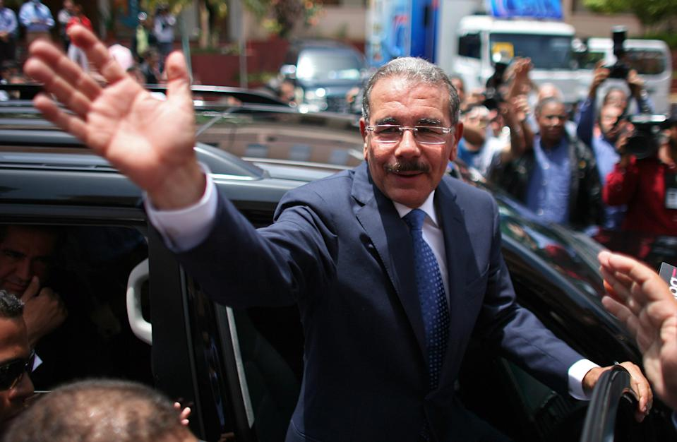 Danilo Medina, presidential candidate of the ruling Dominican Liberation Party, cheers to the crowd while leaving a polling station after casting his ballot during the presidential election in Santo Domingo, Dominican Republic, Sunday May 20, 2012. (AP Photo/Ricardo Arduengo)