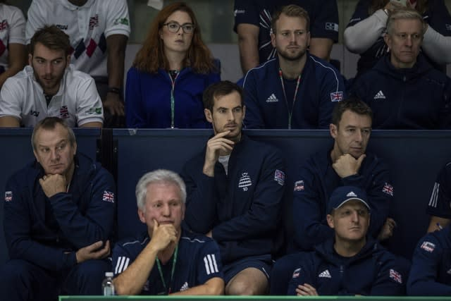 Andy Murray, centre, watched from the stands on Thursday (Bernat Armangue/AP).