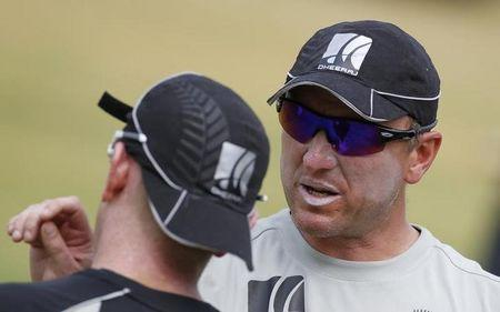 New Zealand's bowling coach Donald talks to his team player Styris during a cricket practice session in Chennai