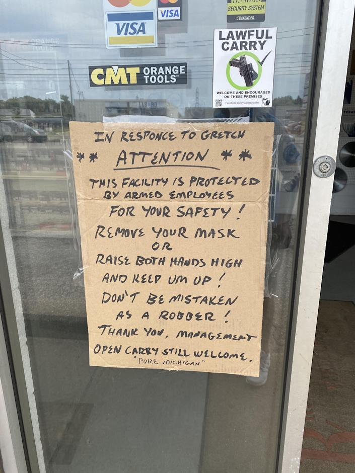 A sign in front of Tubergen Cutting Tools Inc. in Kentwood, Mich. implies customers who wear masks will be treated as criminals, on Tuesday, July 14. The owner of the metal-cutting shop said the sign is meant as a display of humor.