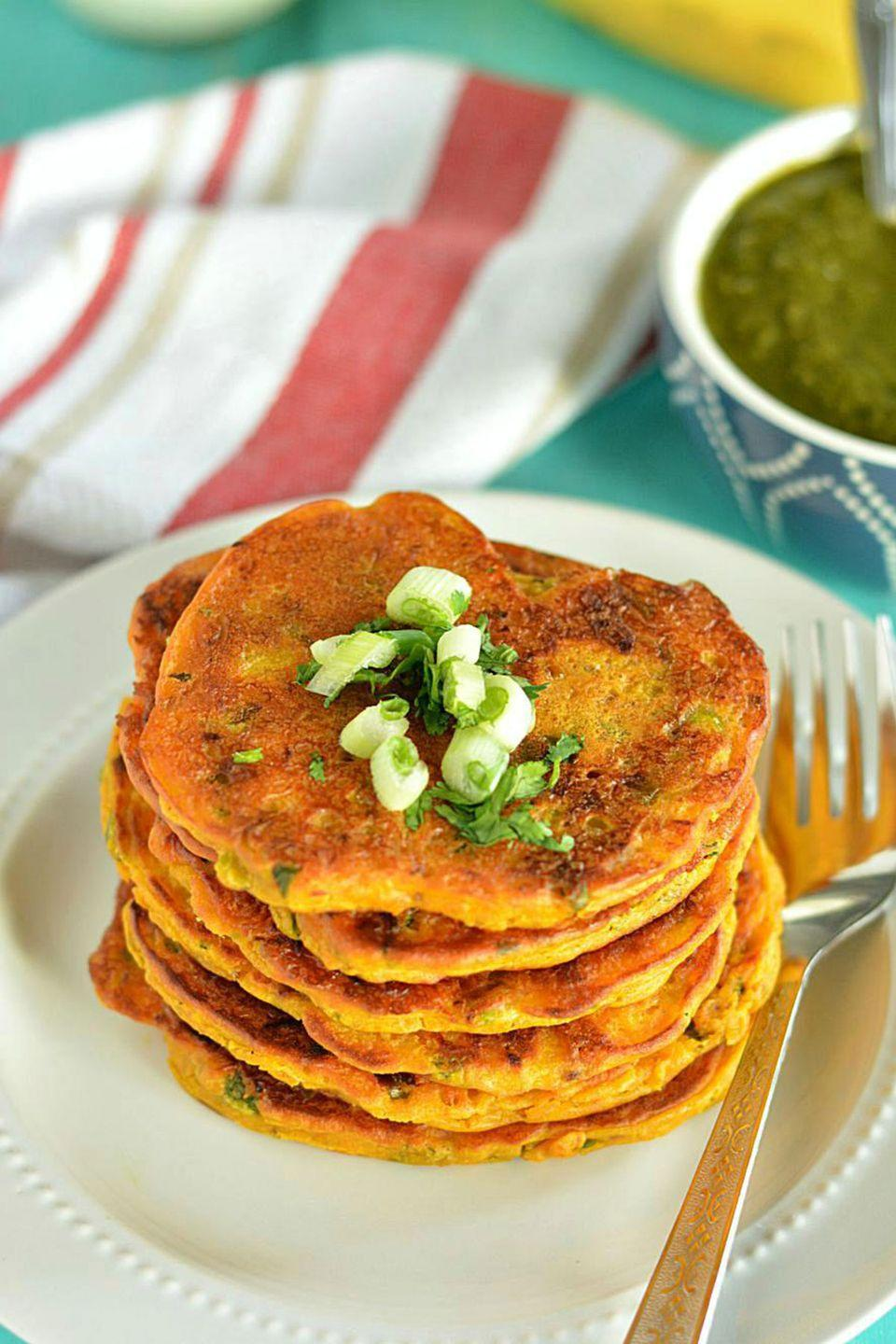 """<p>These flavorful pumpkin pancakes are worth getting out of bed for! You can make them for breakfast, lunch, or dinner.</p><p><strong>Get the recipe at <a href=""""http://www.ruchiskitchen.com/recipe/savory-pumpkin-pancakes/"""" rel=""""nofollow noopener"""" target=""""_blank"""" data-ylk=""""slk:Ruchi's Kitchen"""" class=""""link rapid-noclick-resp"""">Ruchi's Kitchen</a>.</strong><br></p><p><a class=""""link rapid-noclick-resp"""" href=""""https://www.amazon.com/dp/B00006IUWL?tag=syn-yahoo-20&ascsubtag=%5Bartid%7C10050.g.619%5Bsrc%7Cyahoo-us"""" rel=""""nofollow noopener"""" target=""""_blank"""" data-ylk=""""slk:SHOP GRIDDLES"""">SHOP GRIDDLES</a></p>"""