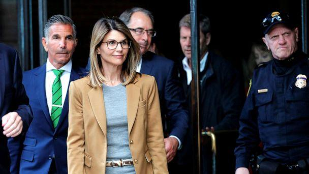PHOTO: Lori Loughlin, and husband Mossimo Giannulli facing charges in a nationwide college admissions cheating scheme, leave federal court in Boston, April 3, 2019. (Brian Snyder/Reuters, FILE)