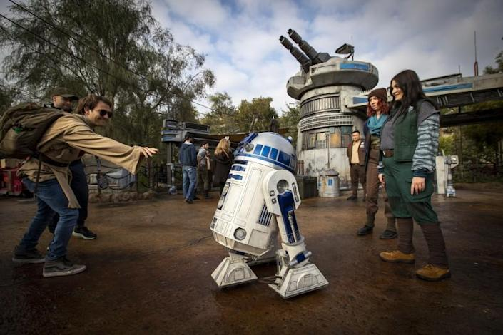 ANAHEIM, CALIF. -- THURSDAY, JANUARY 16, 2020: R2D2 and members of the Resistance interact with members of the media at the entrance featuring a large turret during a preview of Star Wars: Rise of the Resistance Media Preview at the Disneyland Resort in Anaheim, Calif., on Jan. 16, 2020. Star Wars: Galaxy's Edge (Allen J. Schaben / Los Angeles Times)