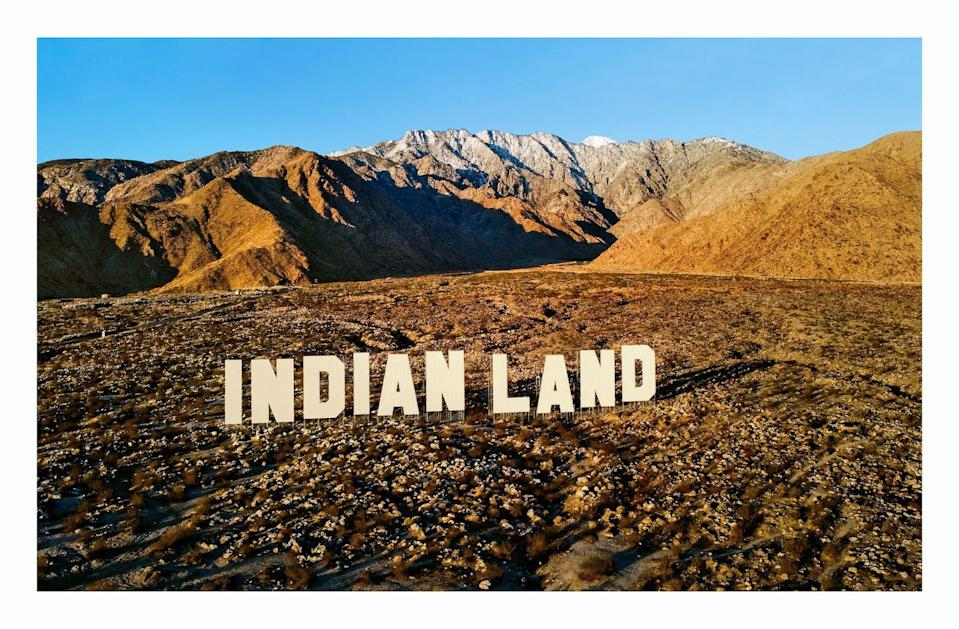 """<p>Nicholas Galanin, an artist of both Tlingit and Unangax̂ descent, installed the words """"Indian Land"""" in the rugged desert landscape outside Palm Springs. They're rendered in 45-foot-tall letters as both a riff on the famed Hollywood sign (which originally <a href=""""https://la.curbed.com/2017/5/18/15505446/hollywood-sign-hike-address-history-font"""" rel=""""nofollow noopener"""" target=""""_blank"""" data-ylk=""""slk:promoted"""" class=""""link rapid-noclick-resp"""">promoted</a> a segregated real estate development in Los Angeles) and as a call to action for property owners to transfer land back to local indigenous communities. Though Peter Blum Gallery showed only a photograph of the work, titled <em>Never Forget,</em> at Frieze, you can see the real thing in California as part of <a href=""""https://desertx.org/"""" rel=""""nofollow noopener"""" target=""""_blank"""" data-ylk=""""slk:Desert X"""" class=""""link rapid-noclick-resp"""">Desert X</a>, through September. </p>"""
