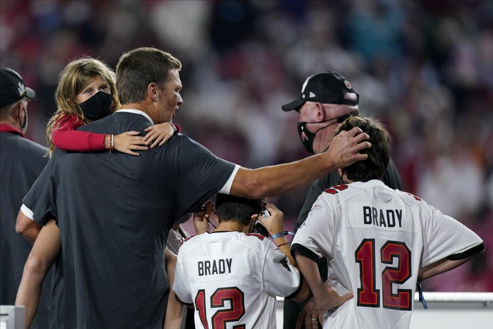 Tampa Bay Buccaneers quarterback Tom Brady celebrates with his children after the NFL Super Bowl 55 football game against the Kansas City Chiefs, Sunday, Feb. 7, 2021, in Tampa, Fla. The Buccaneers defeated the Chiefs 31-9 to win the Super Bowl. (AP Photo/Mark Humphrey)