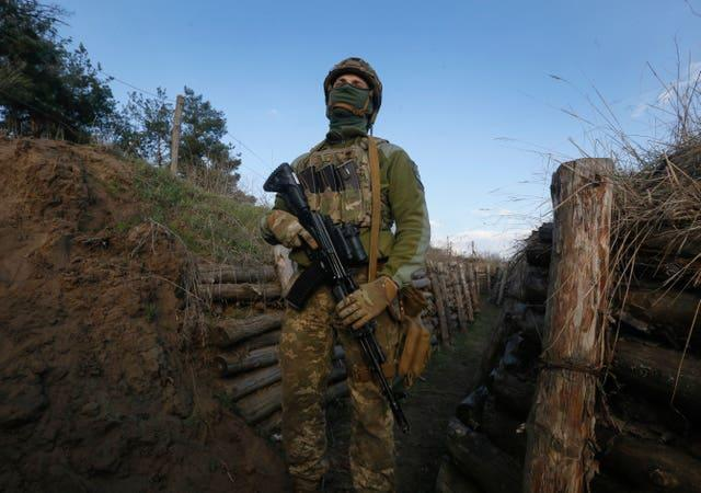 A Ukrainian soldier on the line of separation from pro-Russian rebels near Luhansk, Ukraine