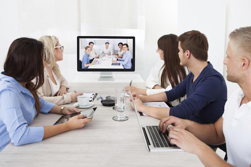 Two groups of people talking to the other in a Zoom Video video conference.