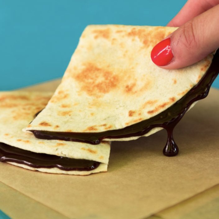<p>This one is really simple, but it sounds oh, so delicious. Take some chocolate chips and place them inside a tortilla. Then this baby is warmed up to achieve chocolatey gooey perfection! </p>