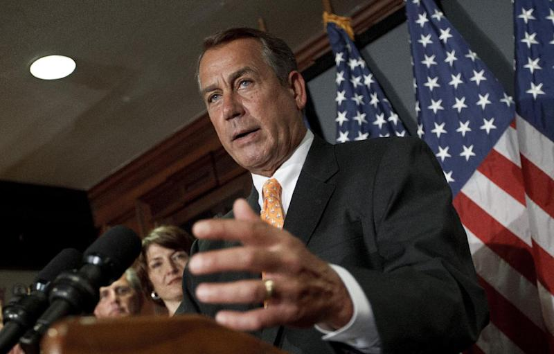 House Speaker John Boehner of Ohio, accompanied by fellow GOP leaders, meets with reporters at the Republican National Committee on Capitol Hill in Washington, Wednesday, Aug. 1, 2012.   (AP Photo/J. Scott Applewhite)