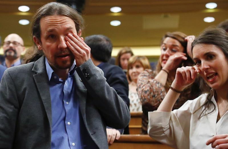 Pablo Iglesias, Unidas Podemos (Together We Can) leader, and his partner, party member Irene Montero react after Spain's Prime Minister Pedro Sanchez won the parliamentary vote following the investiture debate at Parliament in Madrid, Spain, January 7, 2020. REUTERS/Stringer