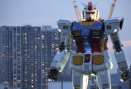 An 18-meter (60-foot) tall Gundam appears at a Tokyo park Saturday, July 11, 2009. The full-size model of Japan's popular robot animation character was built, marking the 30th anniversary of the start of the animation on TV broadcasting. Gundam is a giant robot that has a roll in the era of space wars. (AP Photo/Koji Sasahara)