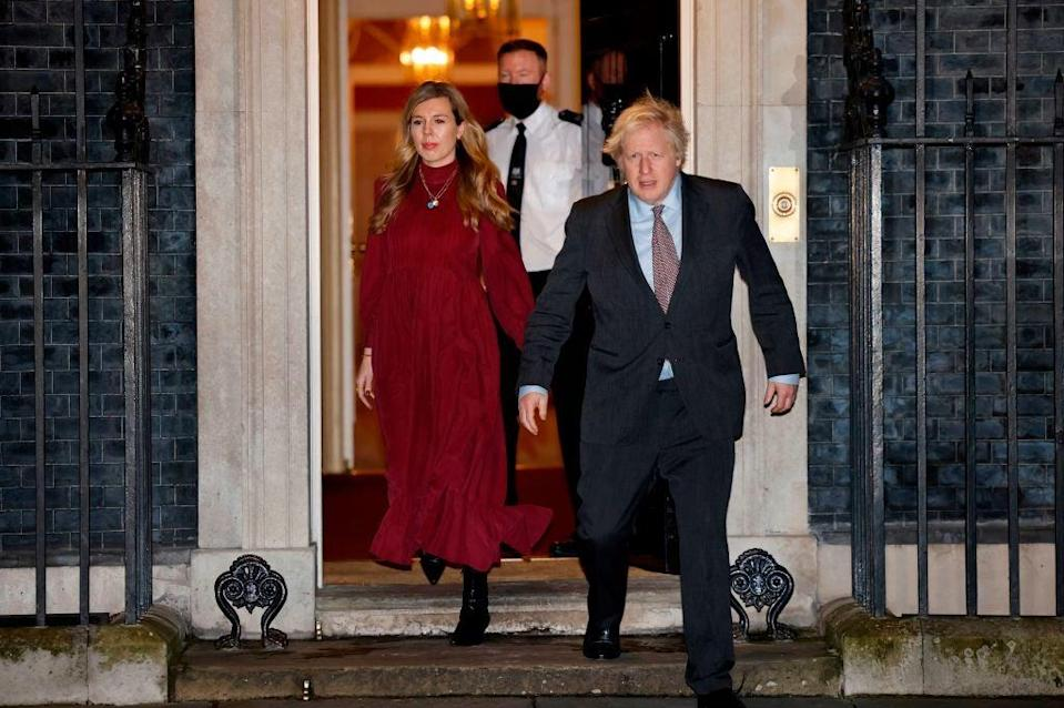 <p>Boris Johnson and his partner Carrie Symonds in Downing Street, where their lavish renovation took place</p> (AFP via Getty Images)