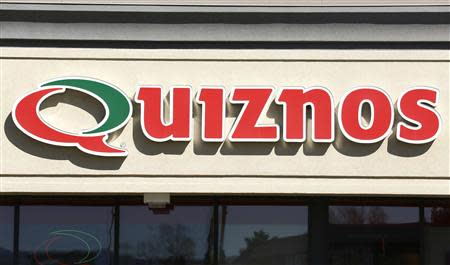 The sign outside a Quiznos store is seen in Westminster, Colorado March 14, 2014. REUTERS/Rick Wilking