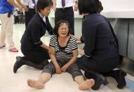 A relative of a passenger on board the crashed TransAsia Airways plane cries in Kaohsiung International Airport, southern Taiwan, July 23, 2014. REUTERS/Stringer